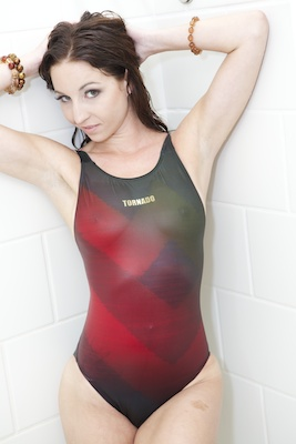 Krystle in a red, maroon, green and black racerback Tornado swimsuit