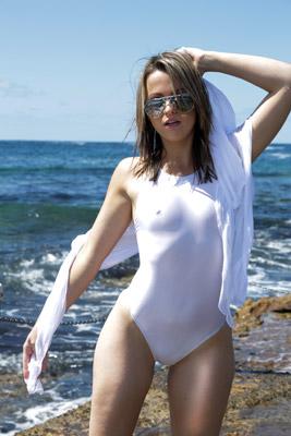 Alexis in a white high leg, racerback Asics swimsuit