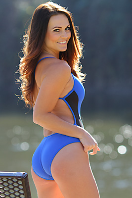 Morgan in a black and electric blue extreme back Speedo swimsuit