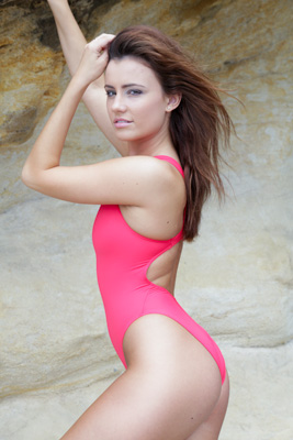 Maria in a hot pink high leg, racerback Realise swimsuit