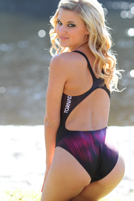 Cyierra in a red, purple and black racerback Tornado swimsuit