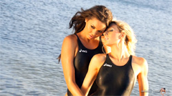 Two lovely ladies in black high leg, racerback Asics swimsuits