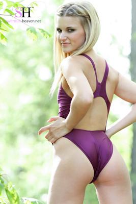 Cyierra in a purple high leg, racerback Asics swimsuit