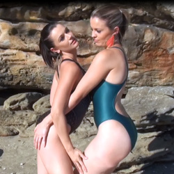 Two lovely ladies in green, black and gold high leg, racerback Asics and JKUSS swimsuits