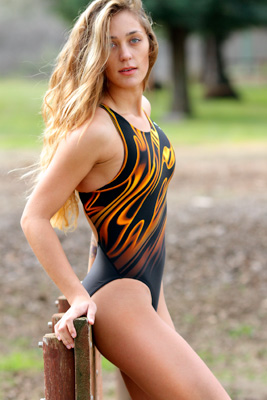 Ashley Light in a yellow, orange and black racerback Tyr swimsuit