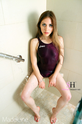 Madeleine in a purple racerback, high leg Asics swimsuit
