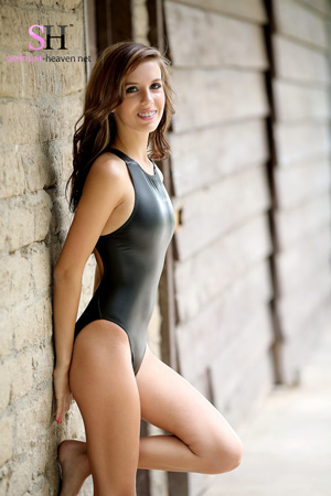 Kelly M in a black high leg, rubberised Realise swimsuit