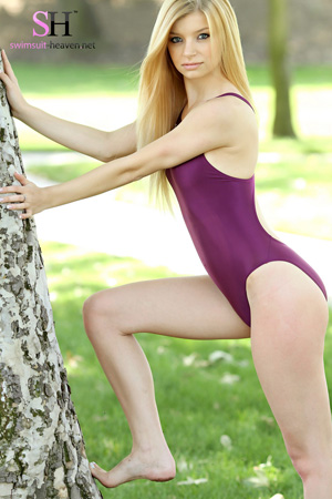 Sharene in a purple high leg, racerback Asics swimsuit
