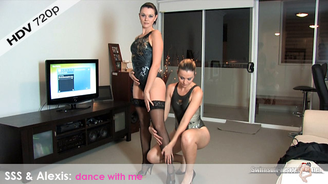 Two lovely ladies in black and gold high leg, racerback JKUSS swimsuits