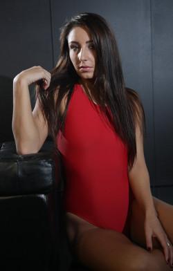 Rochelle in a red racerback, high leg Speedo swimsuit