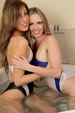 Two lovely ladies in white, red, electric blue and black racerback, high leg Asics swimsuits