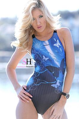 Emily Kae in a blue low back, high leg Nequin swimsuit