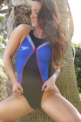 Kristin in a blue and black high leg Speedo swimsuit