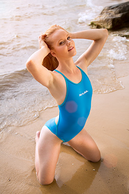 Kandice in a baby blue low neck, pulse back Realise swimsuit