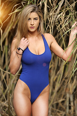 Savannah in an electric blue high leg swimsuit