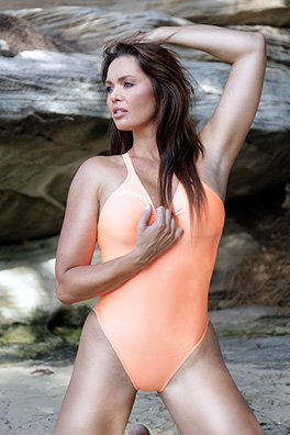 Marissa in an orange high leg Asics swimsuit