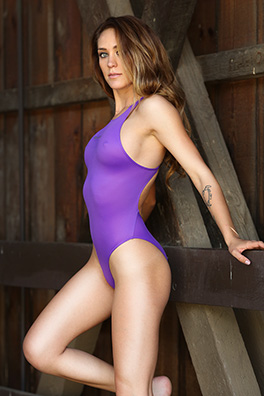 Ashley Light in a purple high leg Realise swimsuit