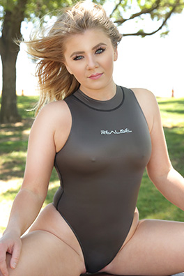 Cailain in a grey zipper back, high neck, high leg Realise swimsuit