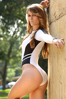 Morgan in a white and black zipper back, long sleeve, high neck, high leg Realise swimsuit