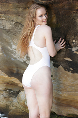 Kandice in a white racerback, high leg Realise swimsuit