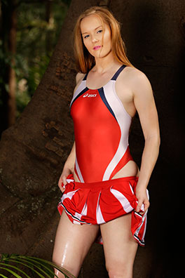 Kandice in a red and white high leg, racerback Asics swimsuit