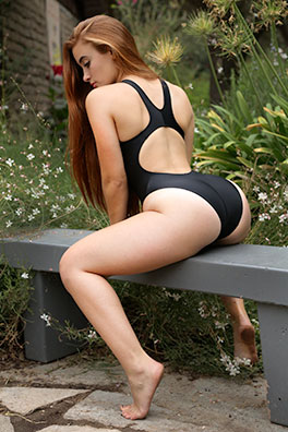 Ginger in a black high leg, racerback Realise swimsuit