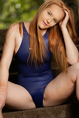 Kandice in a blue high leg, racerback Realise swimsuit