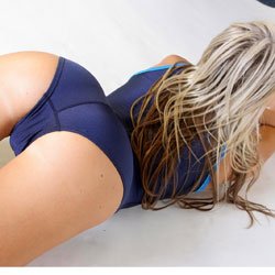 Tash in an electric blue zipper back, high neck, high leg Speedo swimsuit