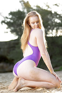 Kandice in a purple racerback, high leg Realise swimsuit