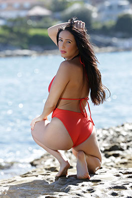 Rochelle in a red low neck, low back, high leg American Apparel swimsuit