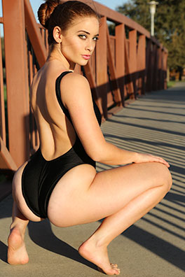 Ginger in a black low neck, low back, leotard, high leg Brigitewear swimsuit