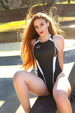 Ginger in a black and white racerback Arena swimsuit