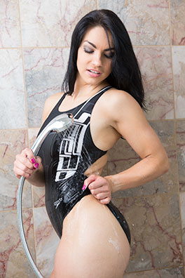 Valentina in a black racerback Speedo swimsuit