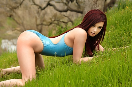 Kylie in a blue and baby blue rubberised, racerback Realise swimsuit