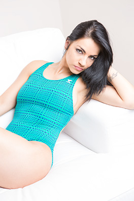 Valentina in a green racerback Tyr swimsuit