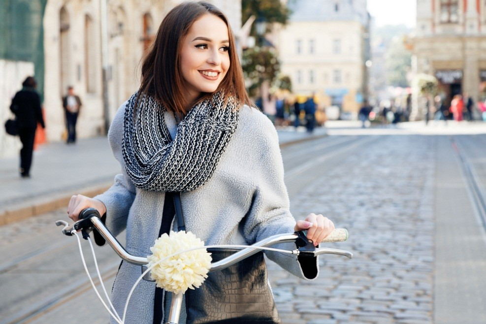 Girl With Scarf on Bicycle
