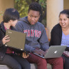 students Nikhita Obeegadoo, Eric Ehizokhale and Sophie Ye working on their laptops / L.A. Cicero