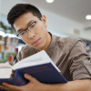 student studying a textbook / Dean Drobot/Shutterstock