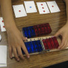 elementary students using hinged tool to study symmetry between positive and negative numbers / Courtesy AAALab@Stanford