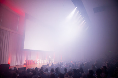 Host David Hornik, obscured by fog effects, delivers a few messages before lunch break. (Photo: L.A Cicero)
