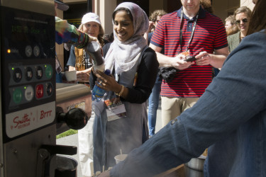 TEDxStanford audience members are treated to a cup of Smitten Ice Cream. (Photo: Tamer Shabani)