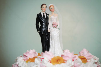 bride and groom figures atop wedding cake