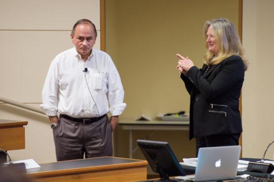 C. Matthew Snipp and Karen Cook standing before the senate.