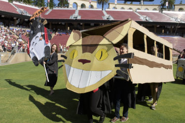 Students dress as their favorite animated charaters walk in the procession