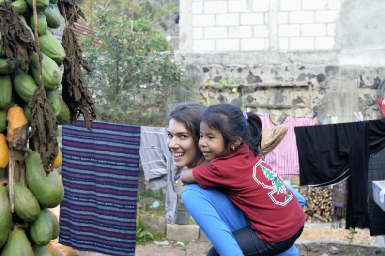 First-year medical student Tori Bawel plans a career improving health in areas of poverty. FátimashowsoffherStanfordgearasshegetsaridefromBawel.BecauseofcontributionsfromFSI,childrenlikeFátimaaregettingthenutritionalsupplementstheyneed.