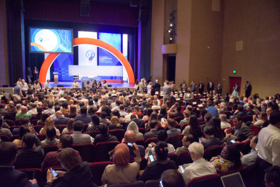 seats in Memorial Auditorium full of people waiting for the plenary session of GES 2016 to begin