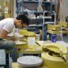 student at a pottery wheel