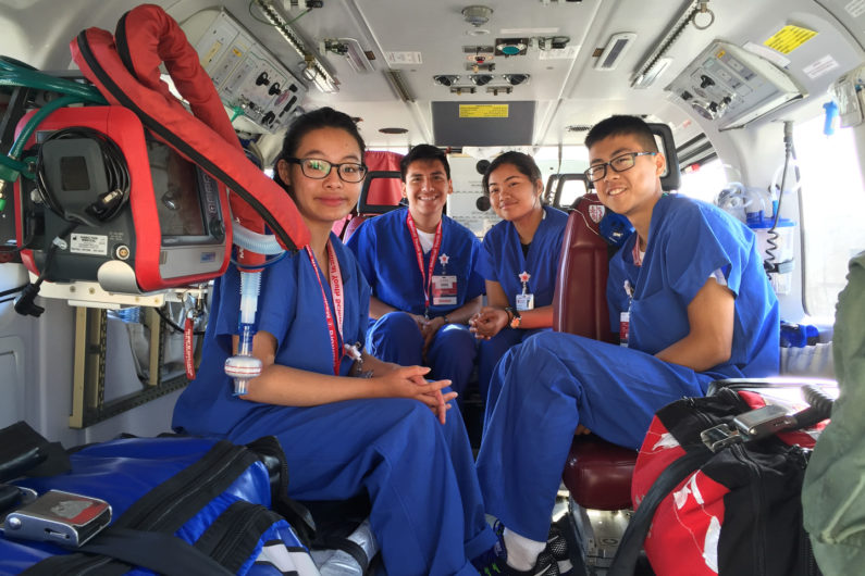 High school students sit in the Stanford Health Care Lifeflight helicopter
