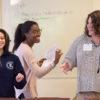 Stanford Anti-Violence Educators Jazzmin Williams, Lola Tijani and Erika Lynn Kneeger lead a practice training session