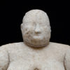 cropped image, head and shoulders of 8,000-year-old-figurine